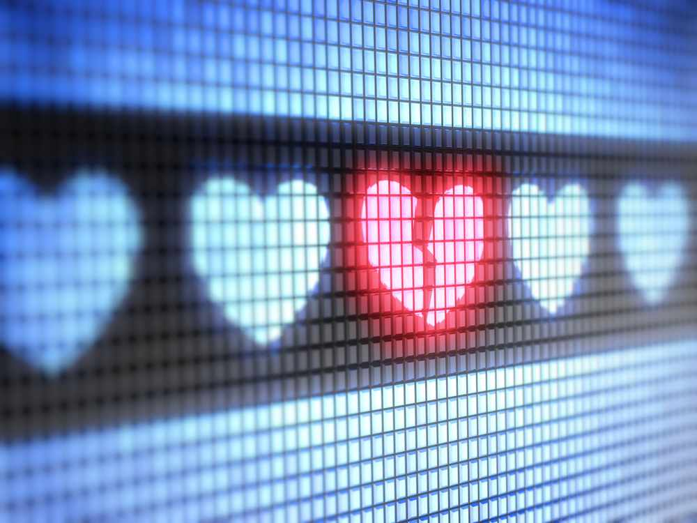heart shape icons on electronic background with broken red heart in middle