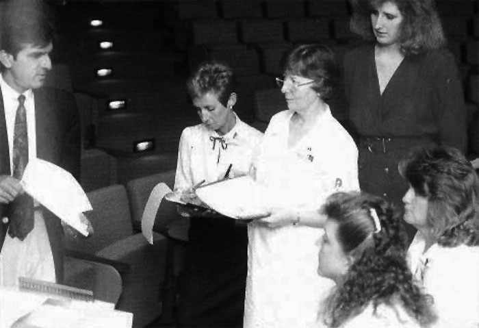 a 1990 photo of Abdul Bengali training (clockwise from left) Arlis Borgstrom, Marilyn Formichella, Tammy Schade, Karin Wallgren and Susan Vold on I-NET