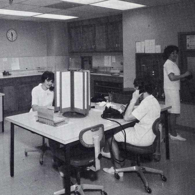 a 1967 photo of Sandra Schaefer, Kathleen Bingham and Diane Atkinson working in the Rochester Methodist Hospital history desk area