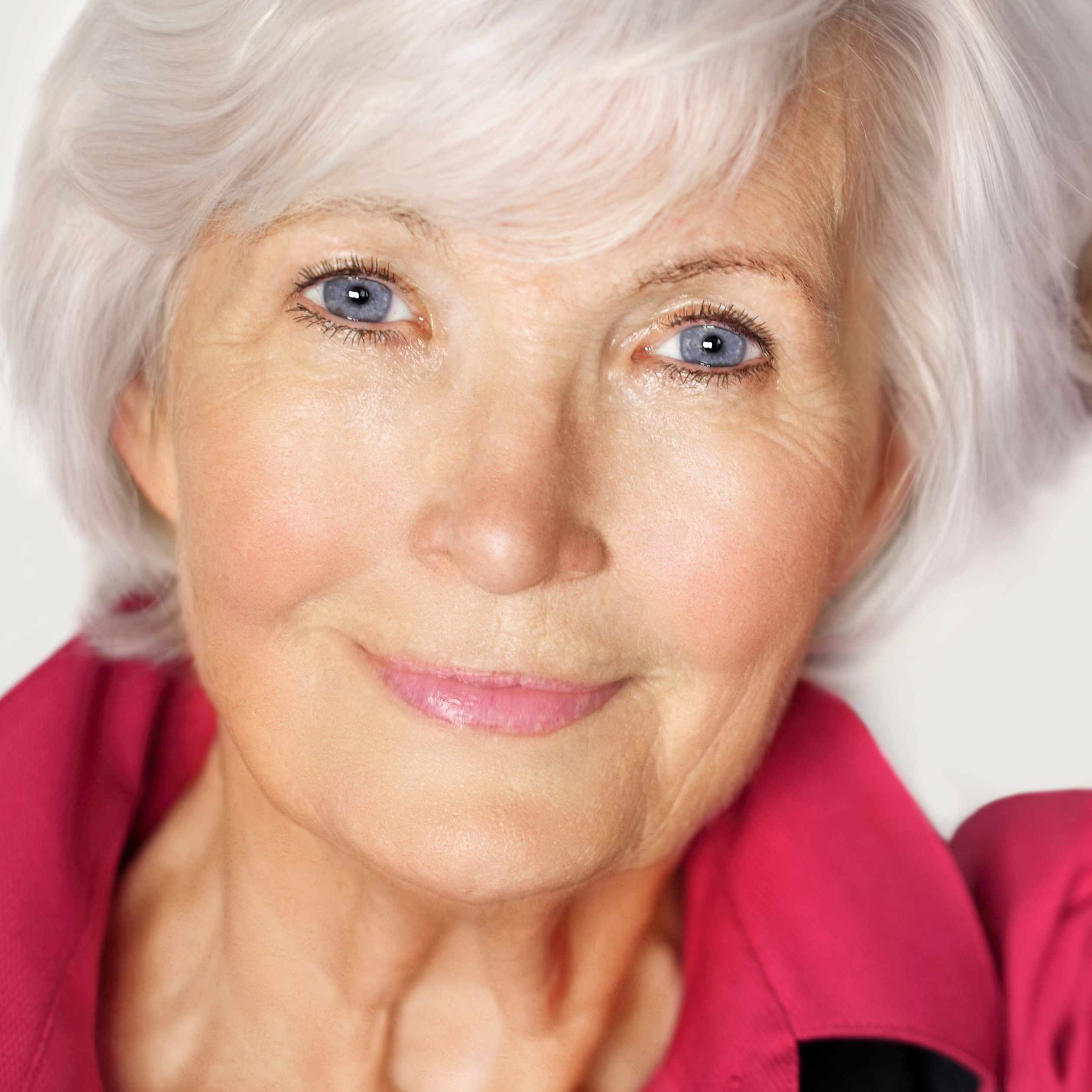 a close-up of a happy, smiling older woman