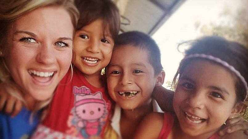 Kate with children in Equador
