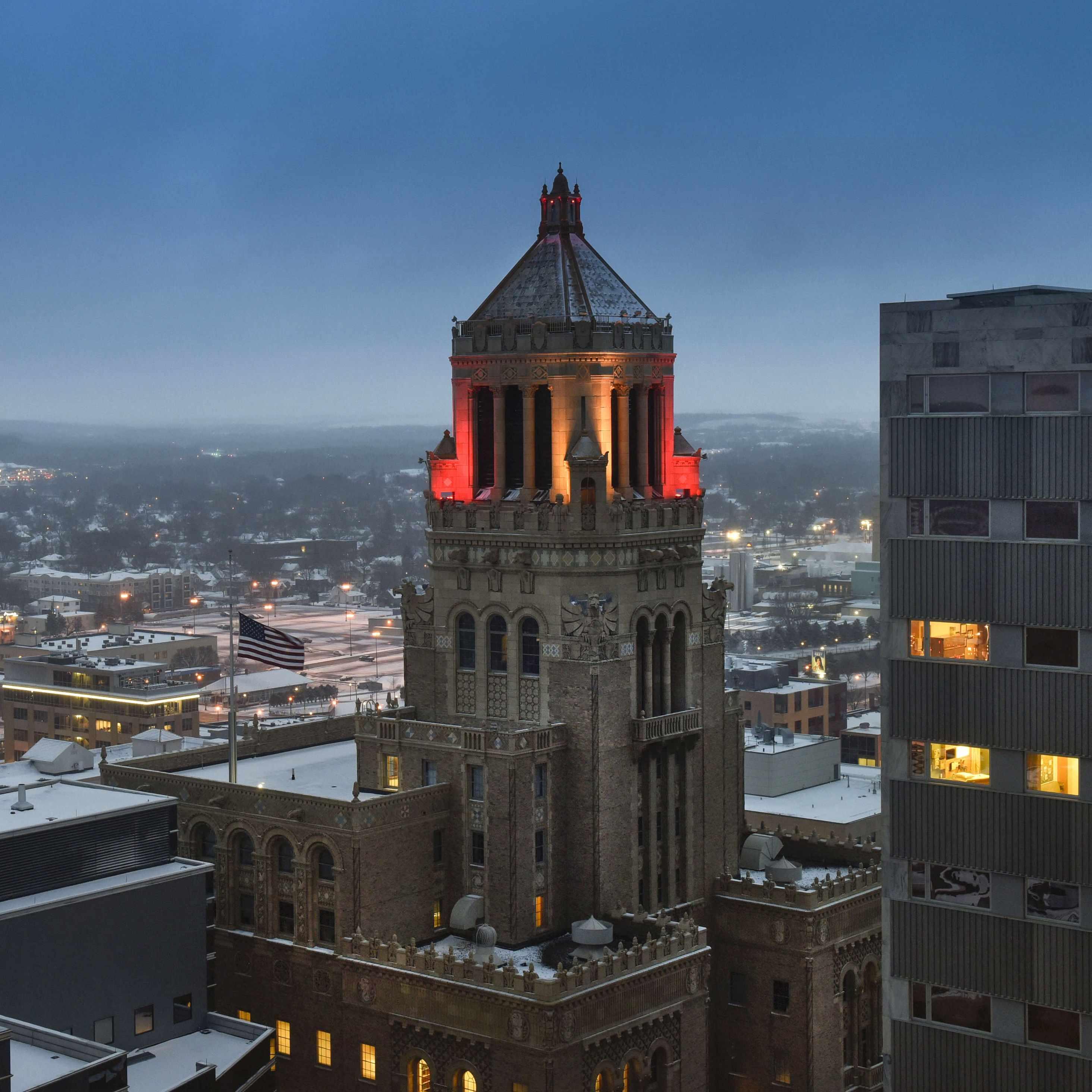 Plummer building lit with red lights