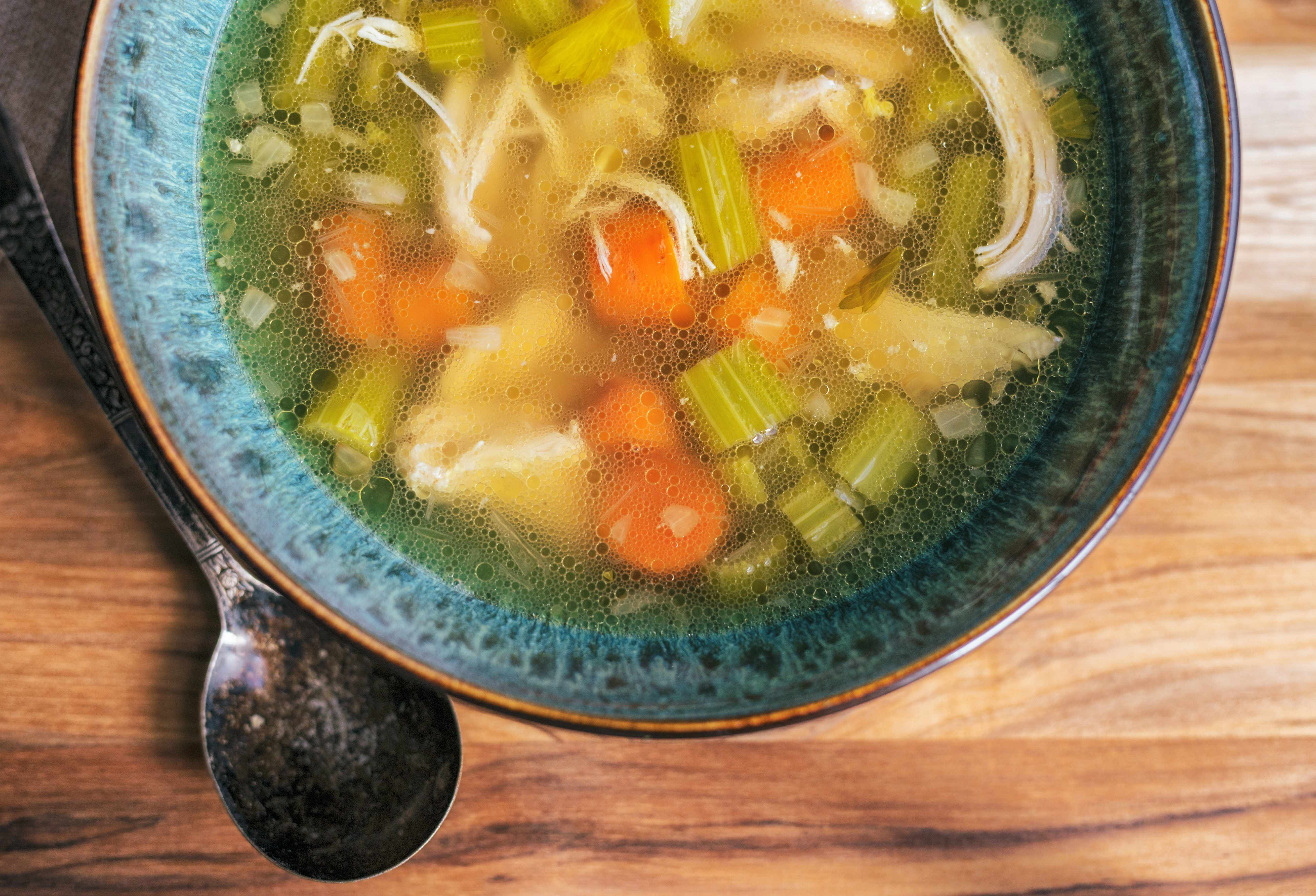 a bowl of homemade chicken broth soup