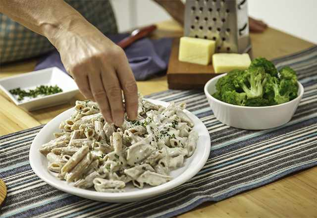 pasta with Alfredo sauce in a white bowl