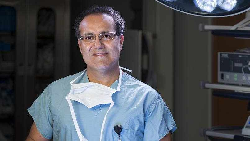 Dr. Quinones in his scrubs in an operating room