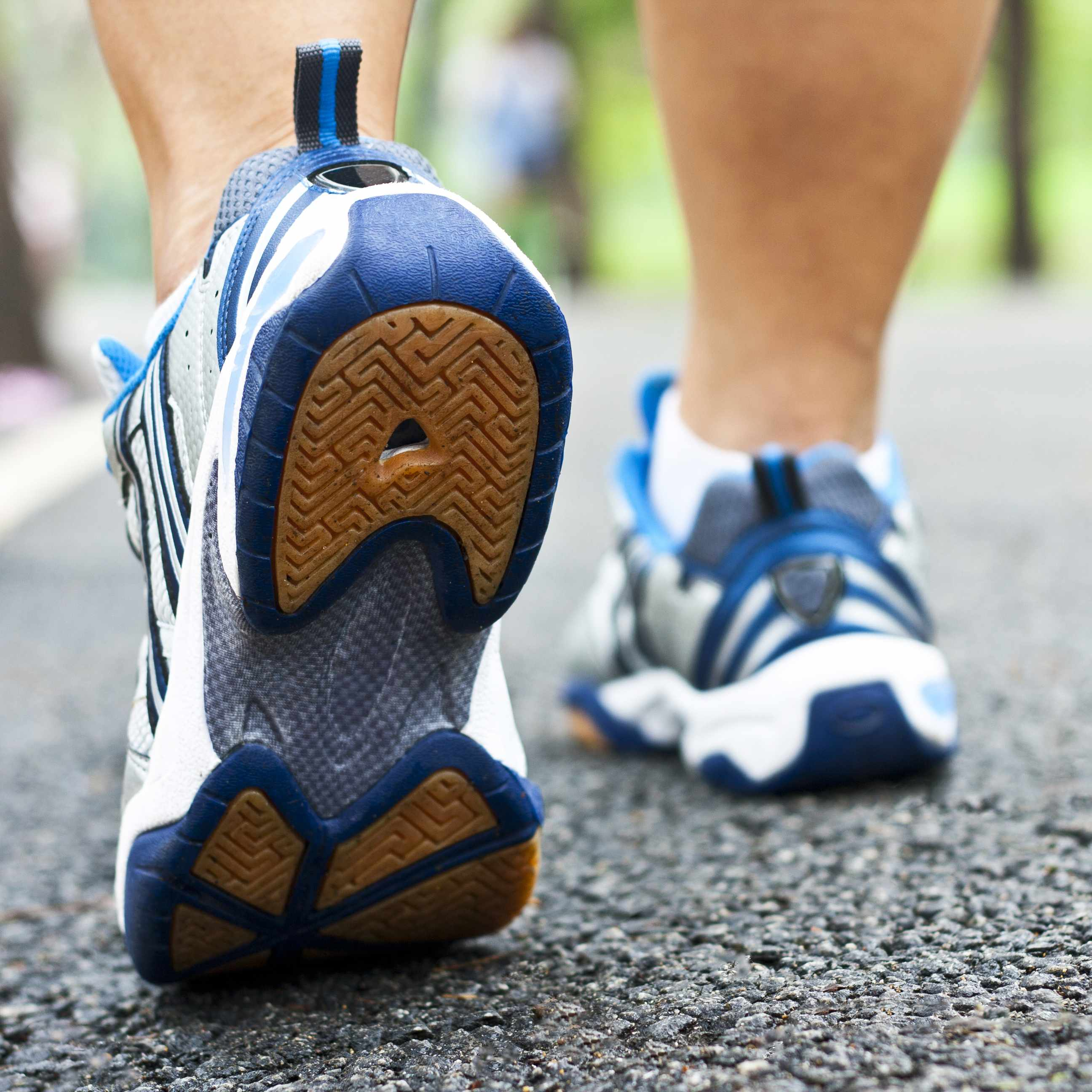 a close-up of a person's lower legs and walking shoes