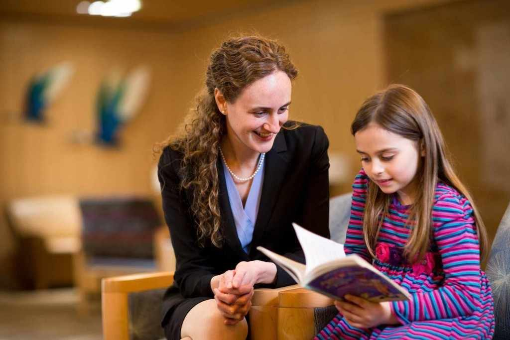 female doctor counselor and young child girl pediatric patient