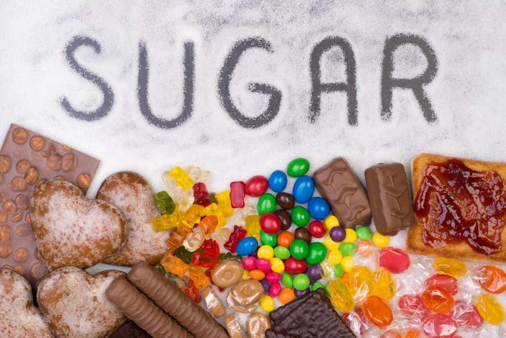 the word sugar written in sugar and candy