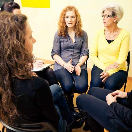 several women in conversation in group setting