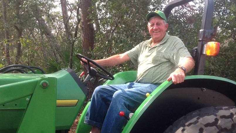 stroke patient Curtis Wood on his tractor