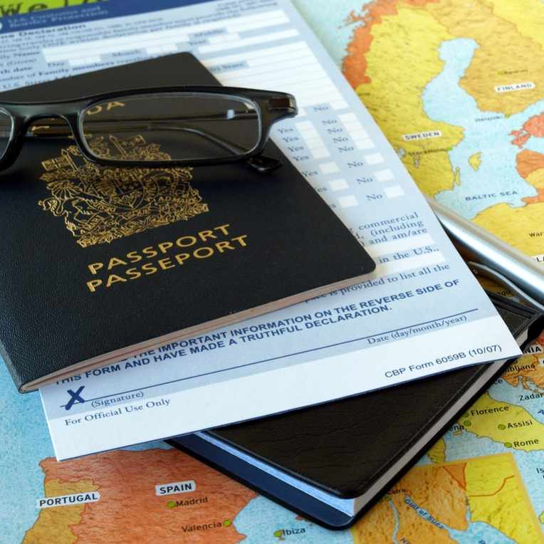 traveling materials with a map, glasses and a passport