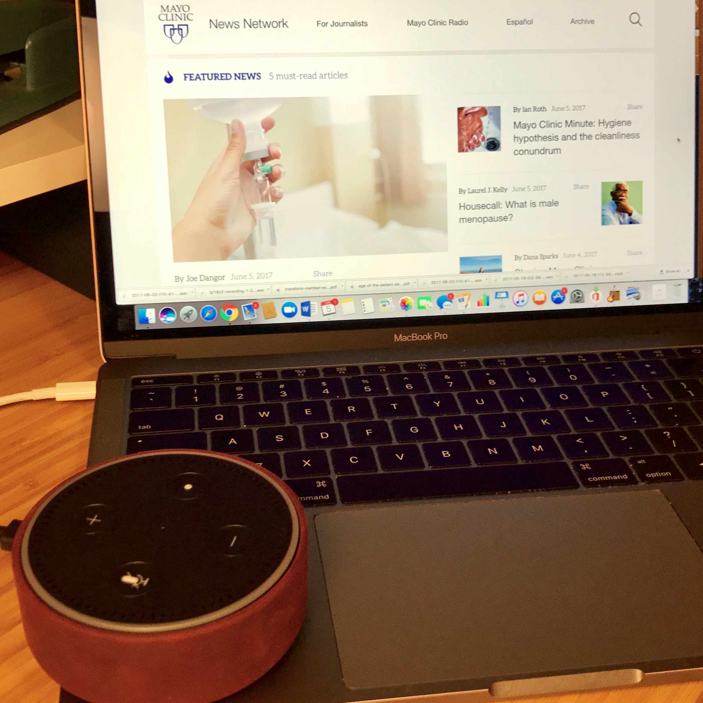 An Amazon Echo Dot rests on a laptop computer displaying an image of the Mayo Clinic News Network