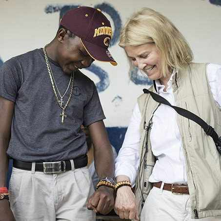 patient from Liberia, Sampson, walking and smiling with Greta Van Susteren