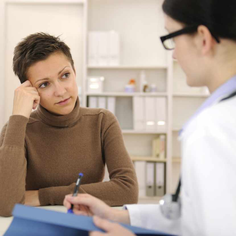 worried female patient talking with a female health care provider