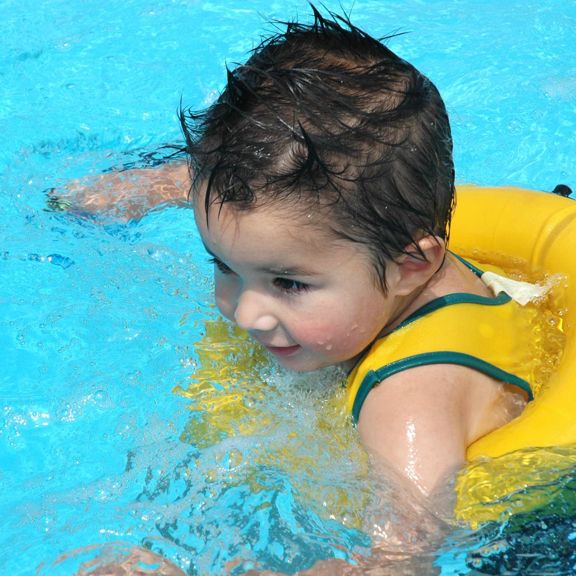 Little boy swimming in pool