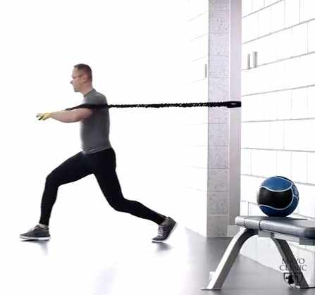 a man exercising with stretch bands