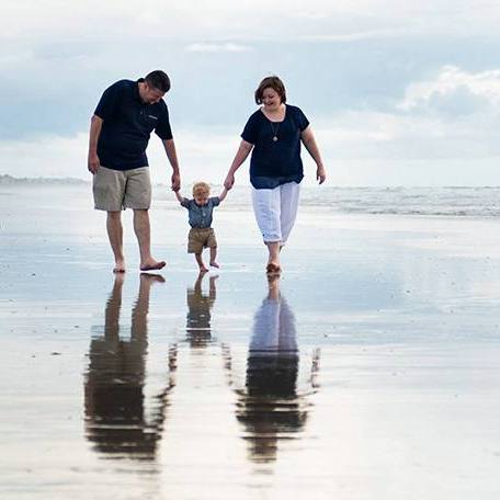 cardiac patient Collin Markum walking on the beach with his wife and little boy