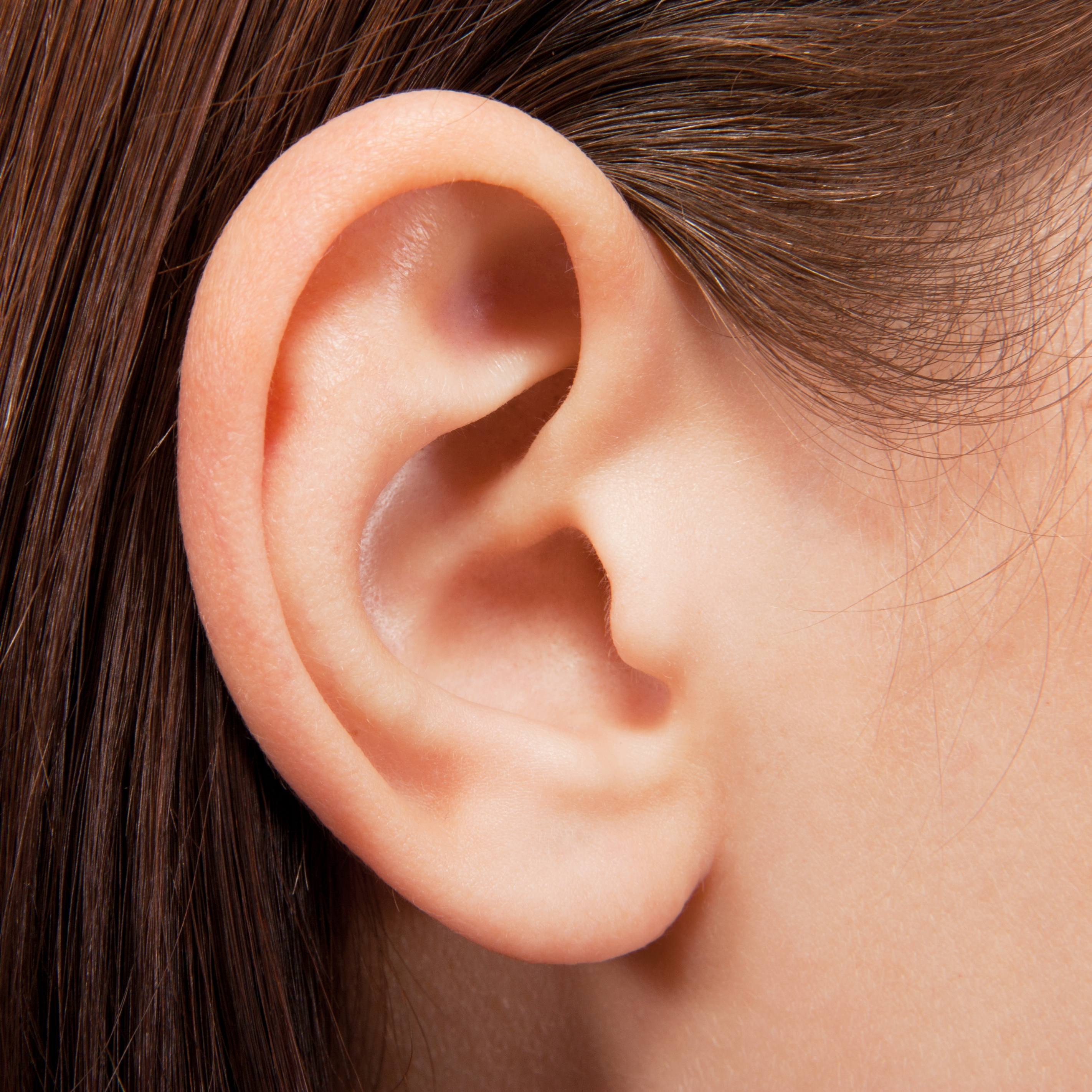 a closeup of a young girl's ear