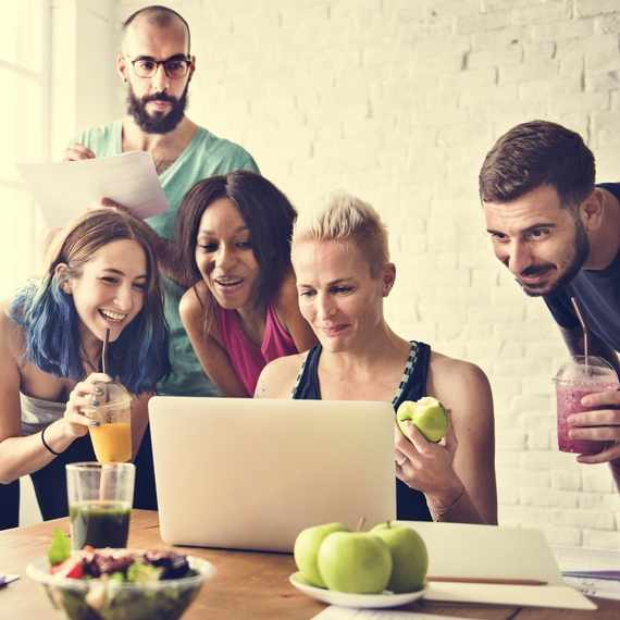 Group of millennials eating healthy food while researching health