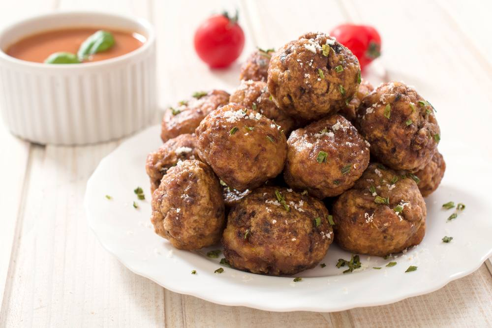 cooked meatballs stacked on a plate
