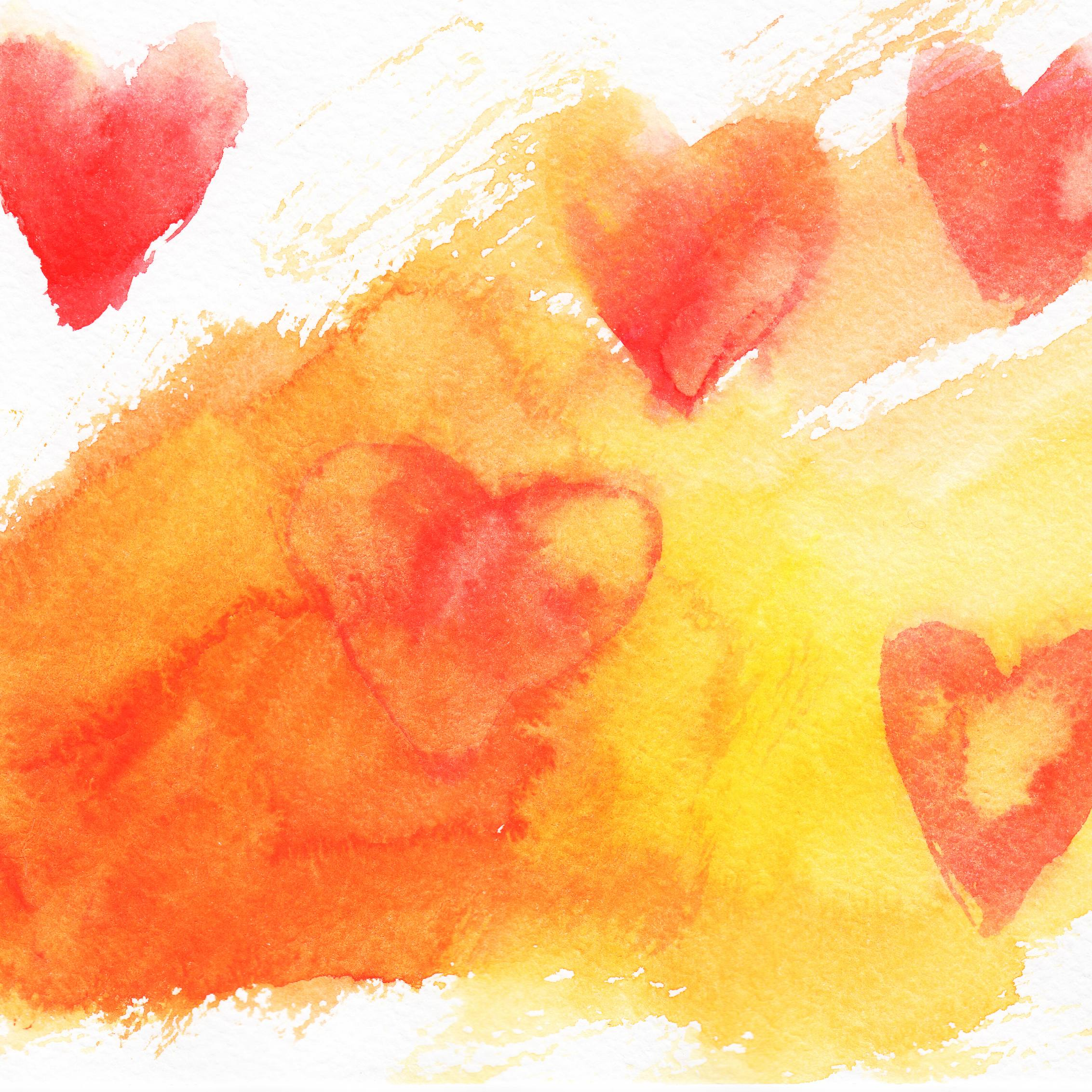a watercolor graphic of a hearts in gold, orange and red