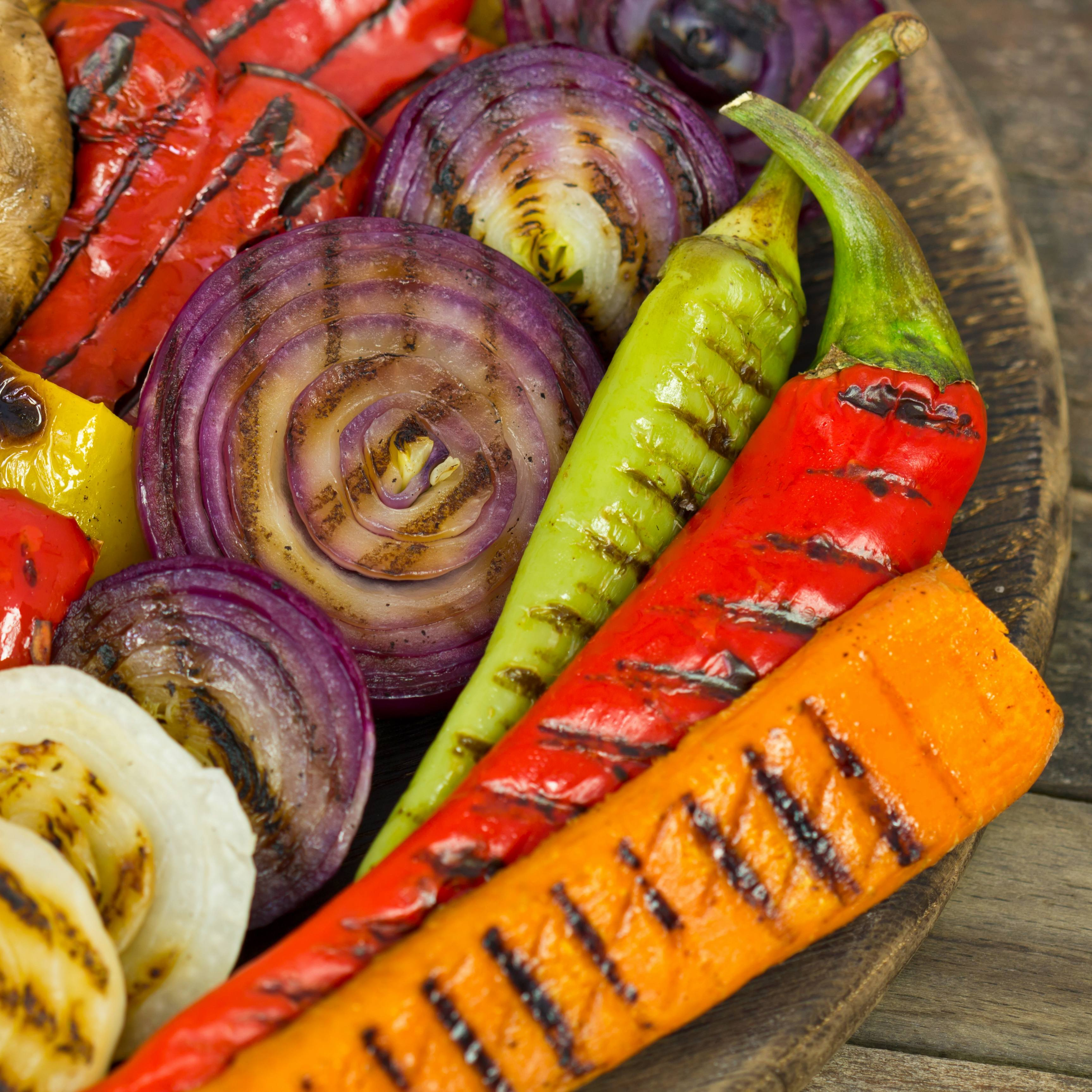 a wooden bowl of freshly roasted vegetables