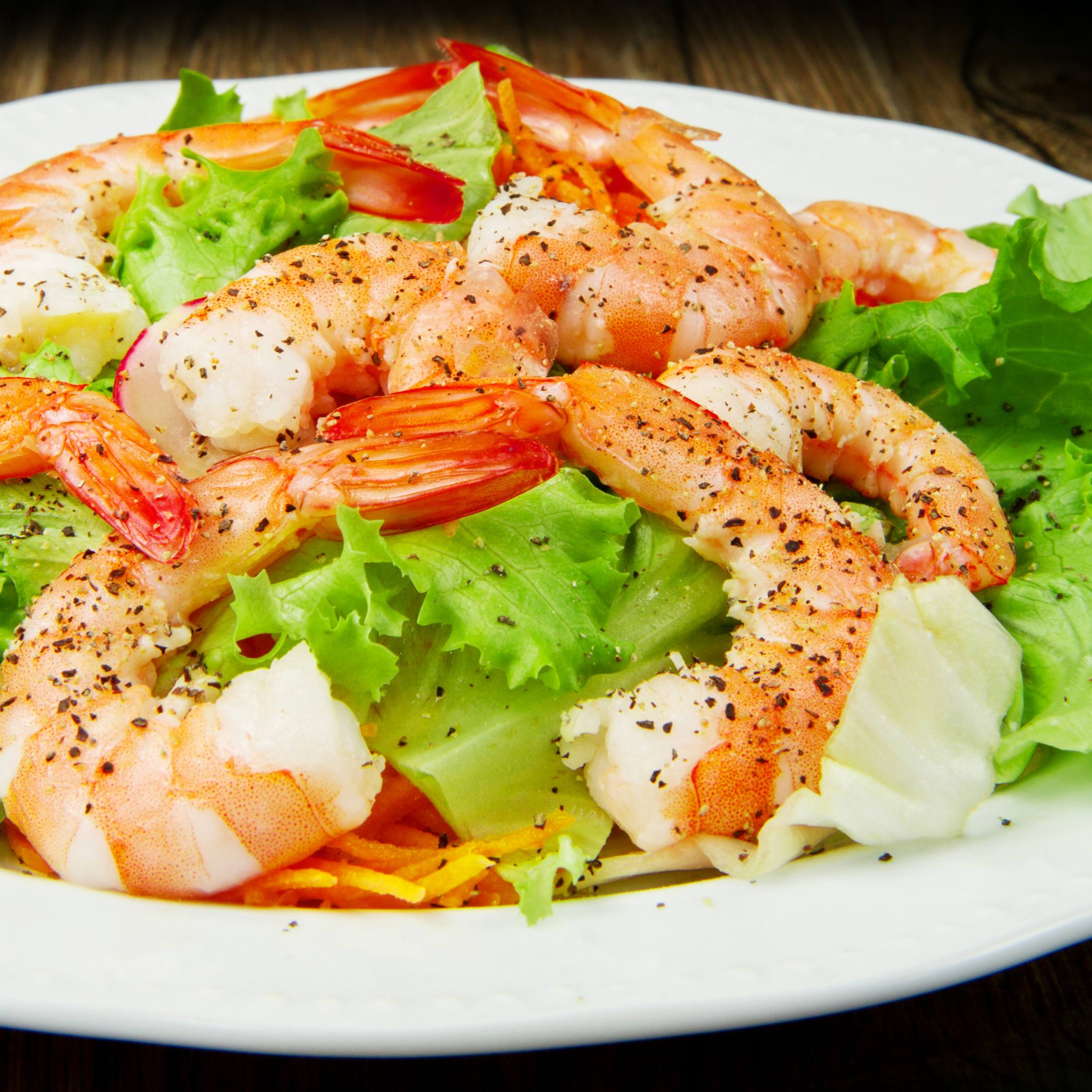 fresh green lettuce salad with shrimp (Omega-3 fatty acids) for good cholesterol (HDL)