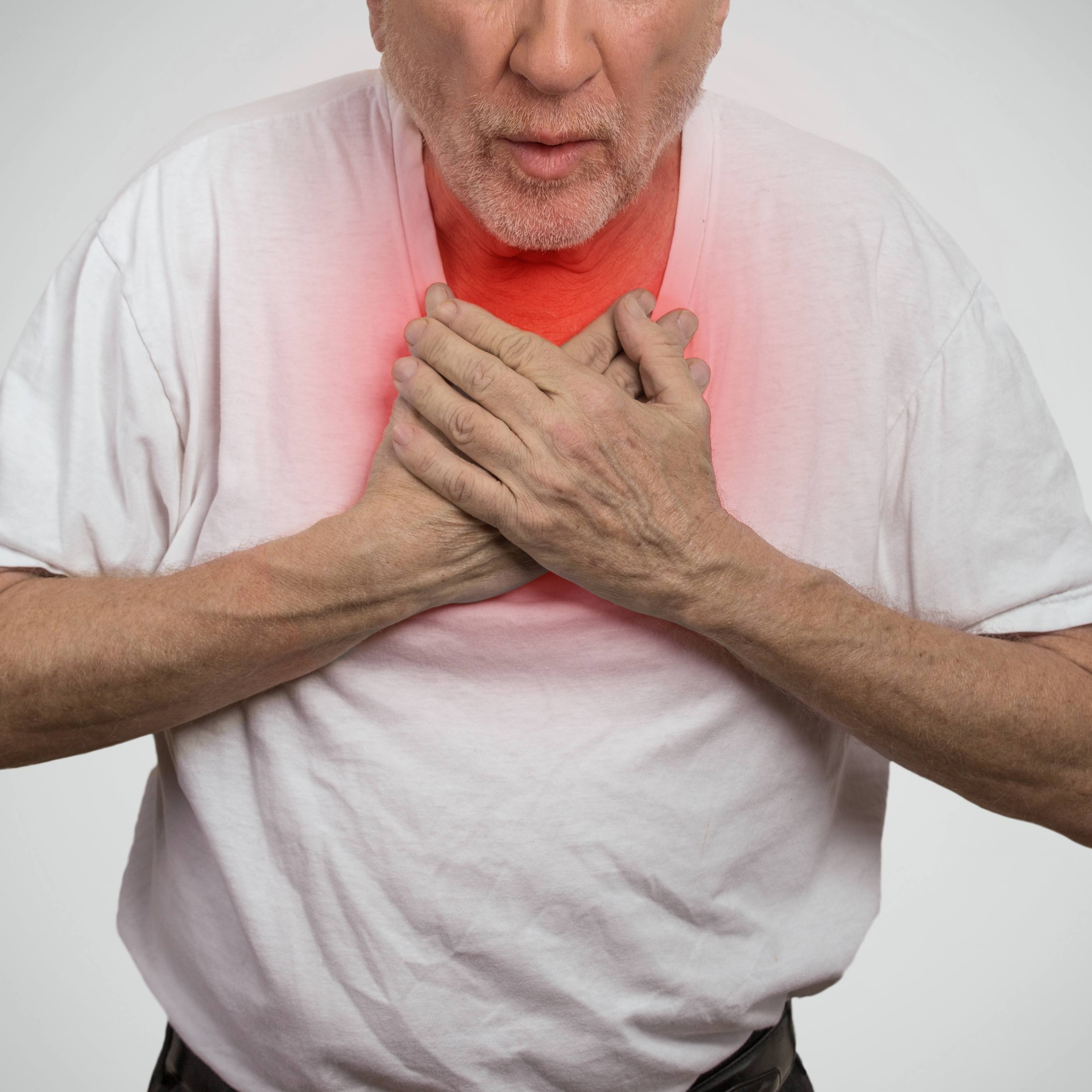 Elderly man having chest pain, trying to catch his breath