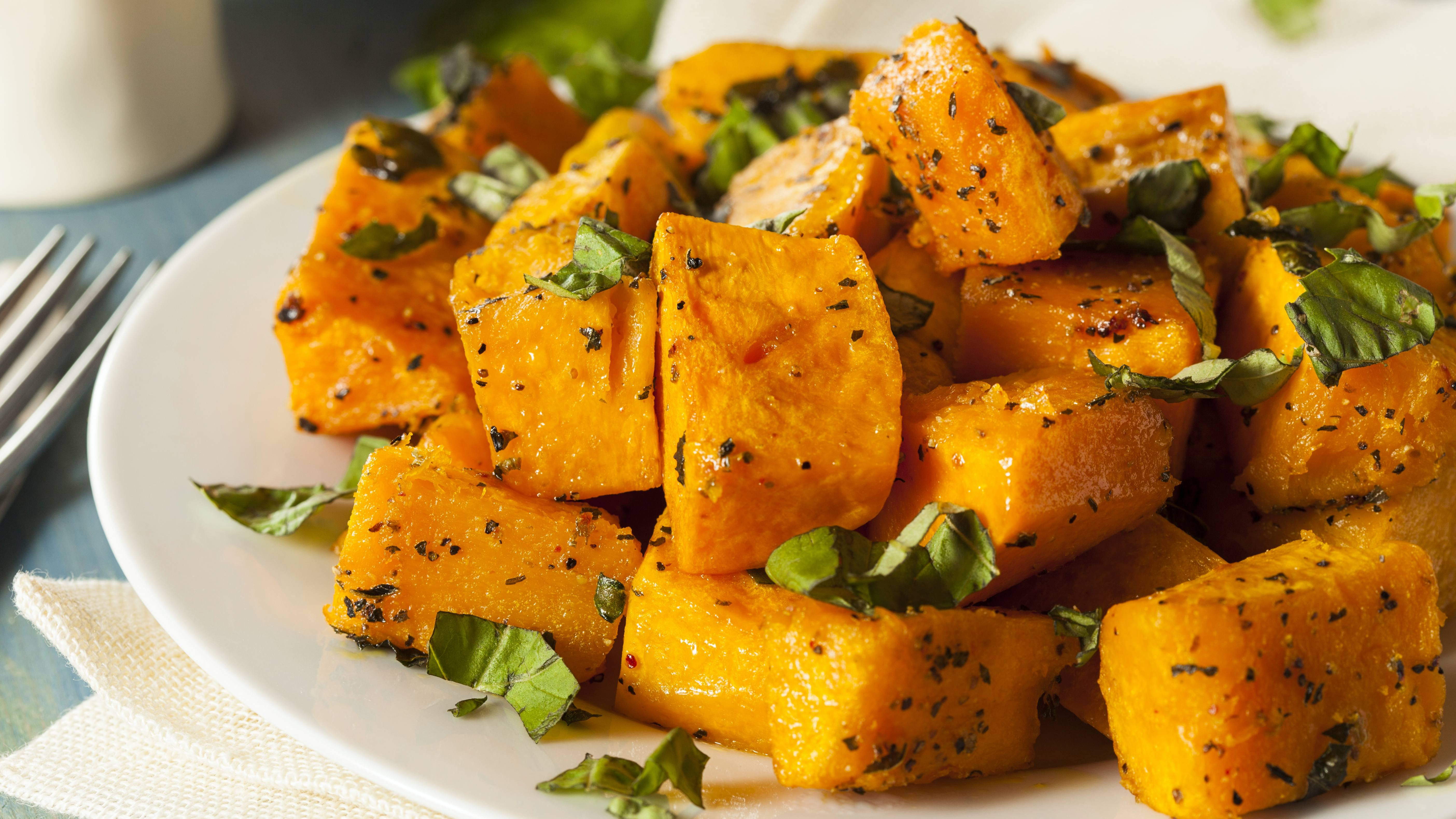 butternut squash pumpkin fries with herbs on a plate