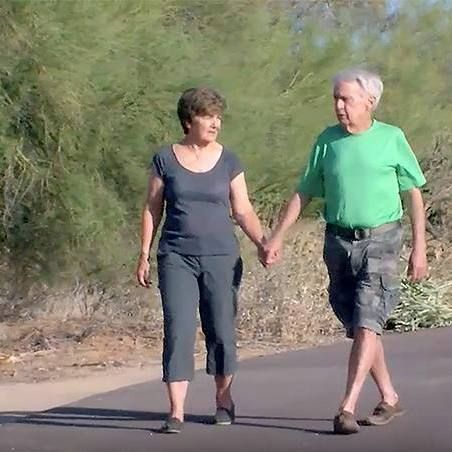 Arizona couple, Vincent and Sandra Streech, fighting cancer together and walking along a road holding hands