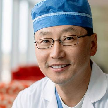 researcher and neurosurgeon Dr. Kendall Lee in his medical scrubs