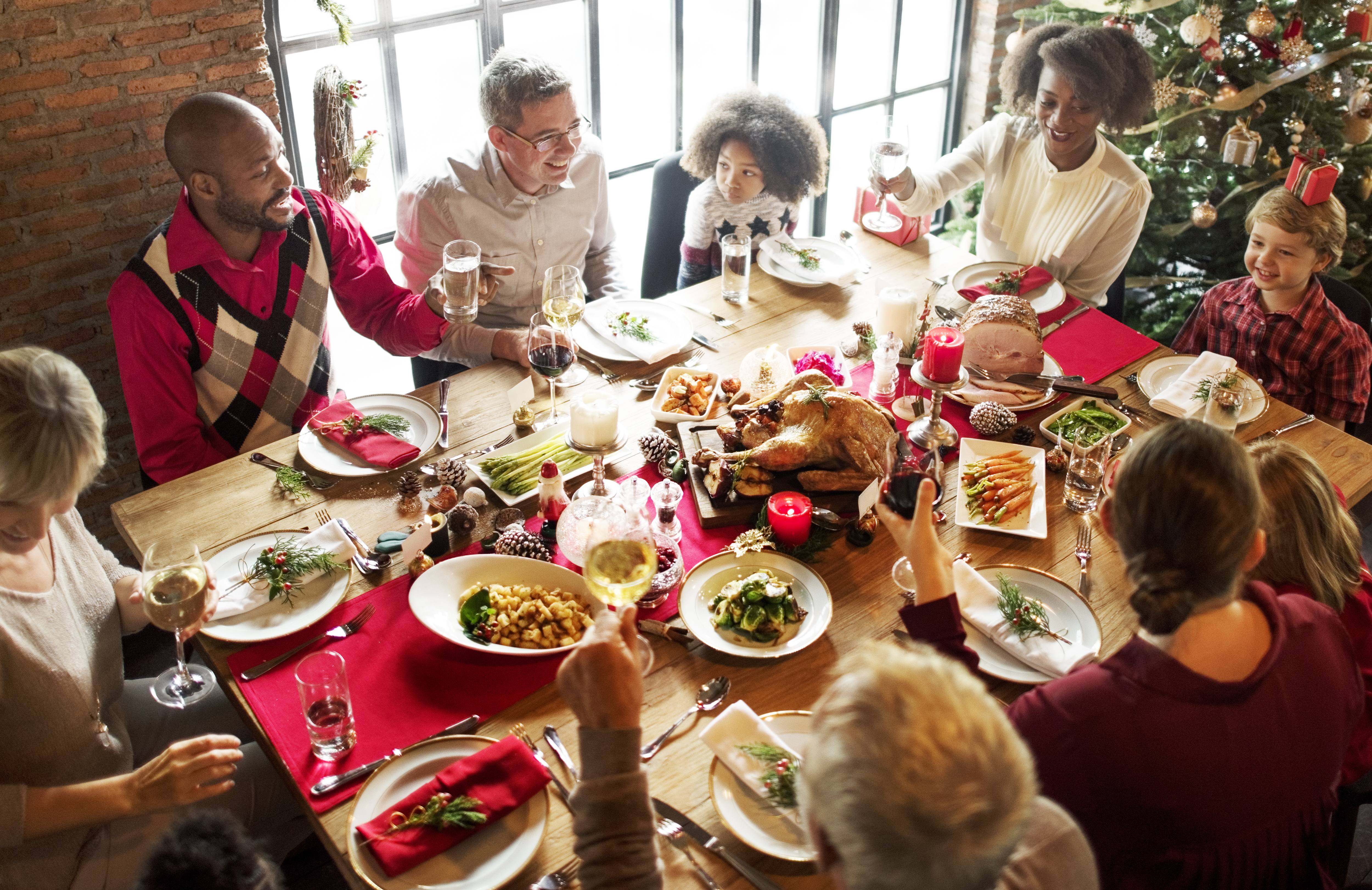 a festive holiday dinner table with family and friends