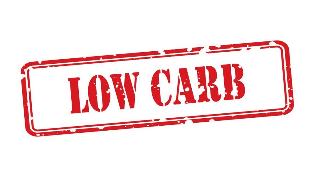 a graphic of an ink stamped sign saying LOW CARB
