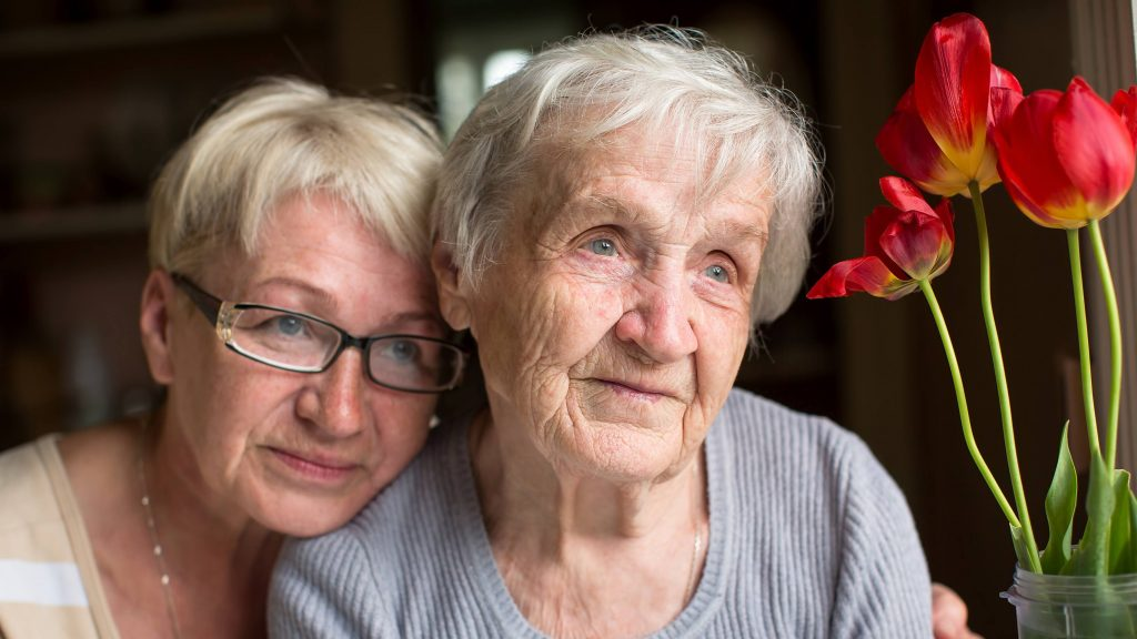 a portrait of two women, one elderly, the other middle age, perhaps a mother and daughter