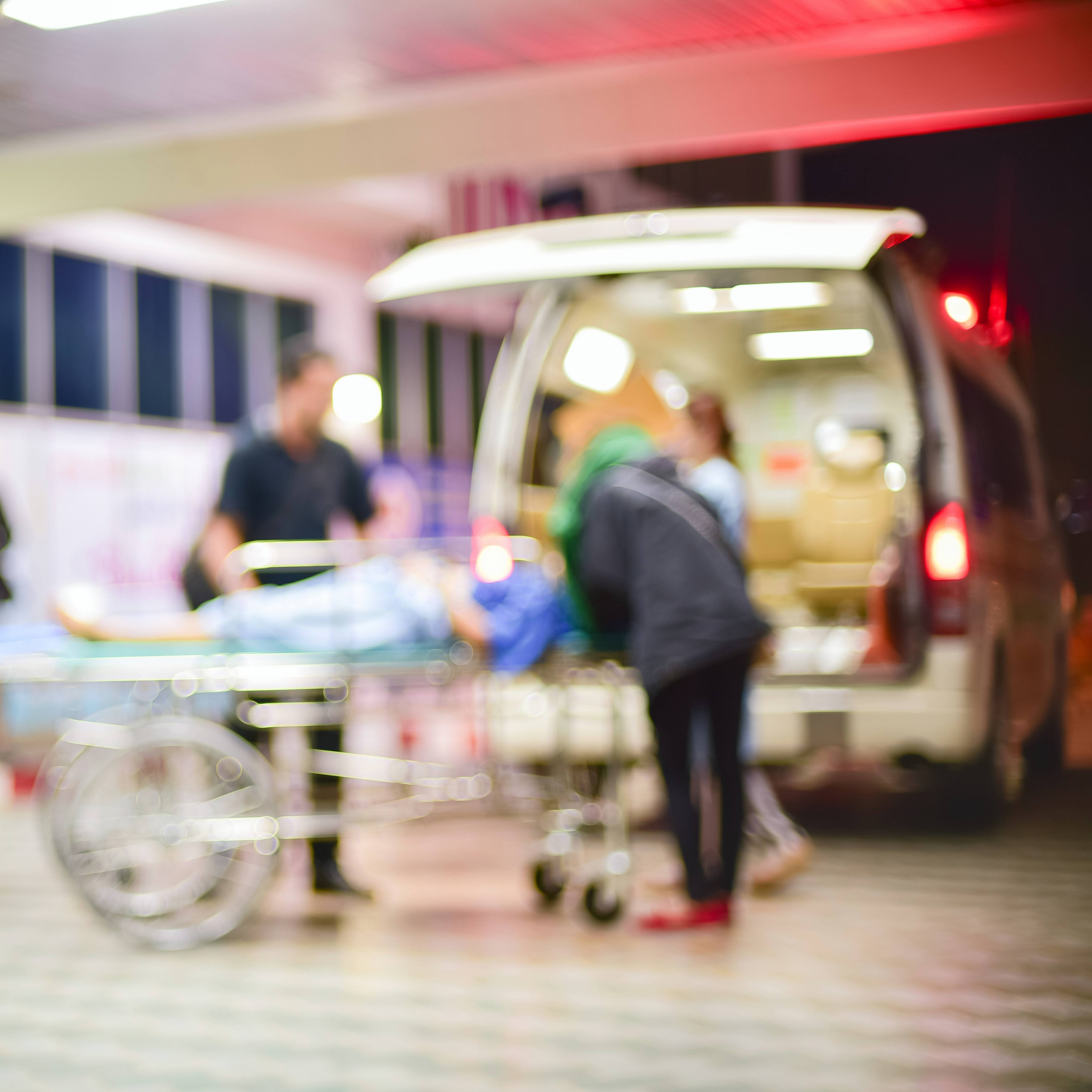 an out of focus blurred picture of an emergency ambulance crew