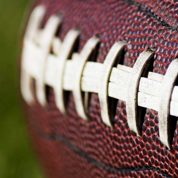 closeup of a football on a field
