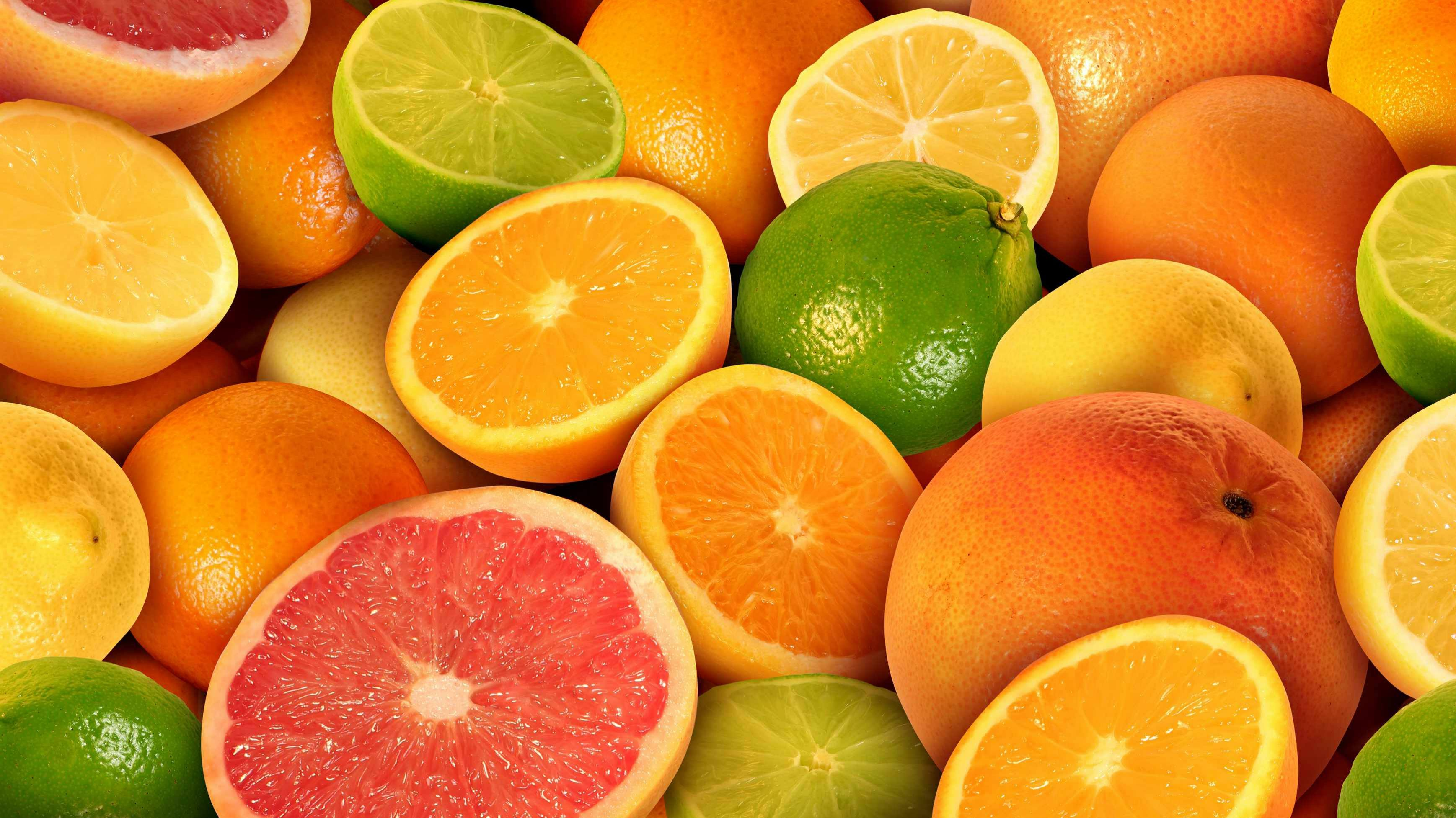 a pile of citrus fruits, oranges, lemons, limes and grapefruits