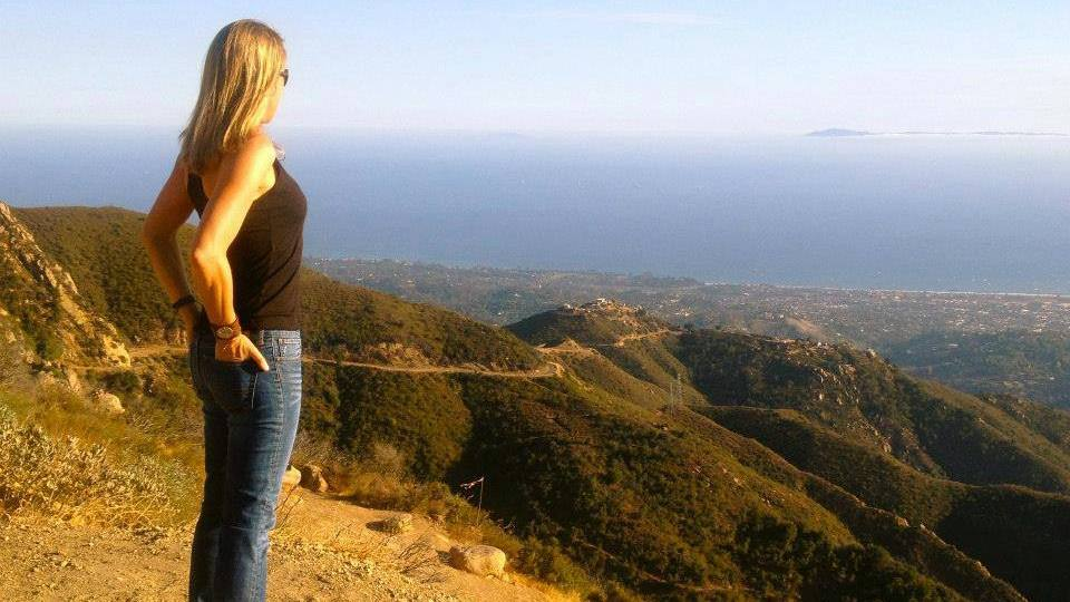 cancer and integrative medicine patient Jennifer Deaderick on a hillside overlooking a valley in California
