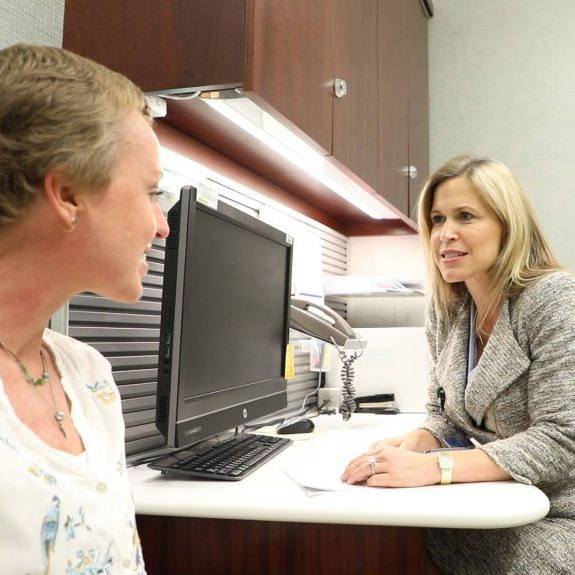 Dr. Dawn Mussallem in her office consulting with breast cancer patient Jennifer Deaderick