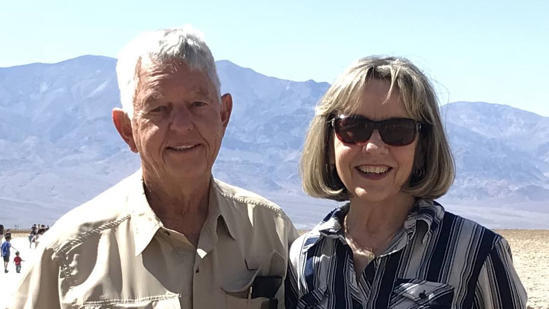 Ken and Martha Settlemire out in the desert and sunshine, smiling and looking happy