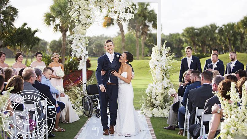 patient Chris Norton and his wife Emily walking down the aisle together at their wedding