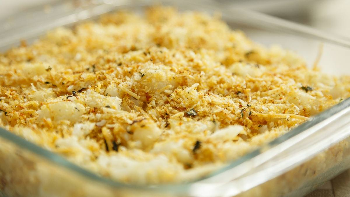 Parmesan roasted cauliflower in a casserole dish