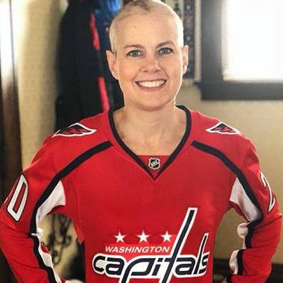 In the Loop cancer patient Amanda Wilson in her Capitals hockey jersey, smiling