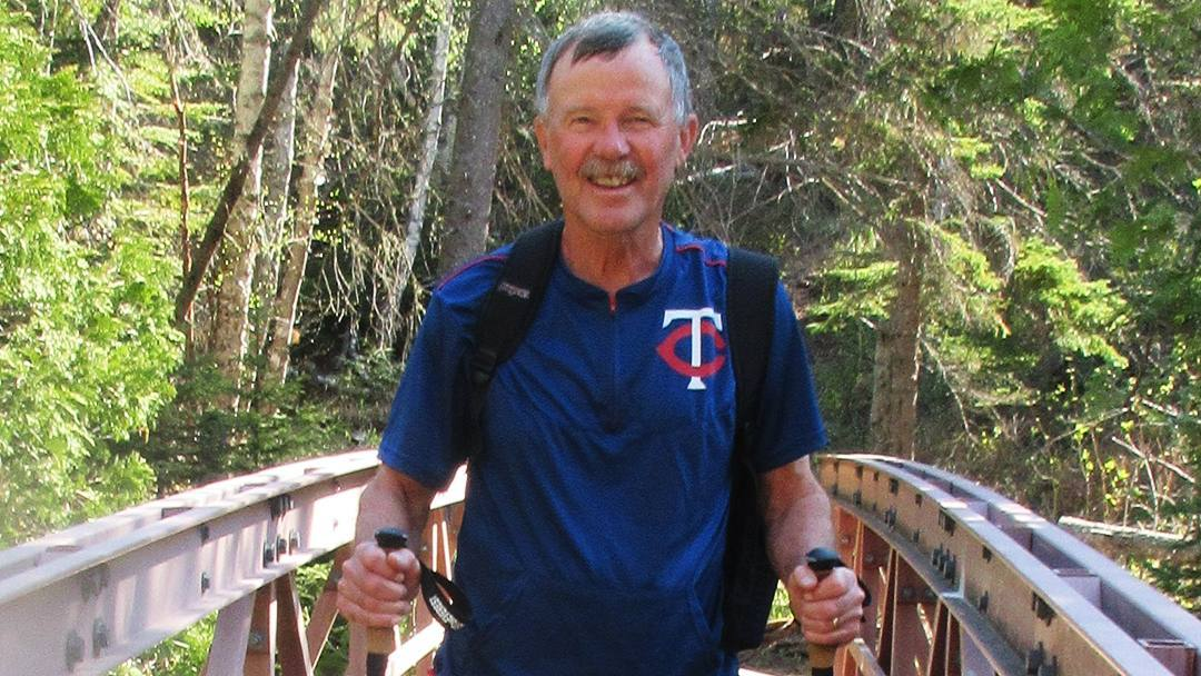 Sharing Mayo Clinic patient Pat Foley out in the forest and hiking on a bridge