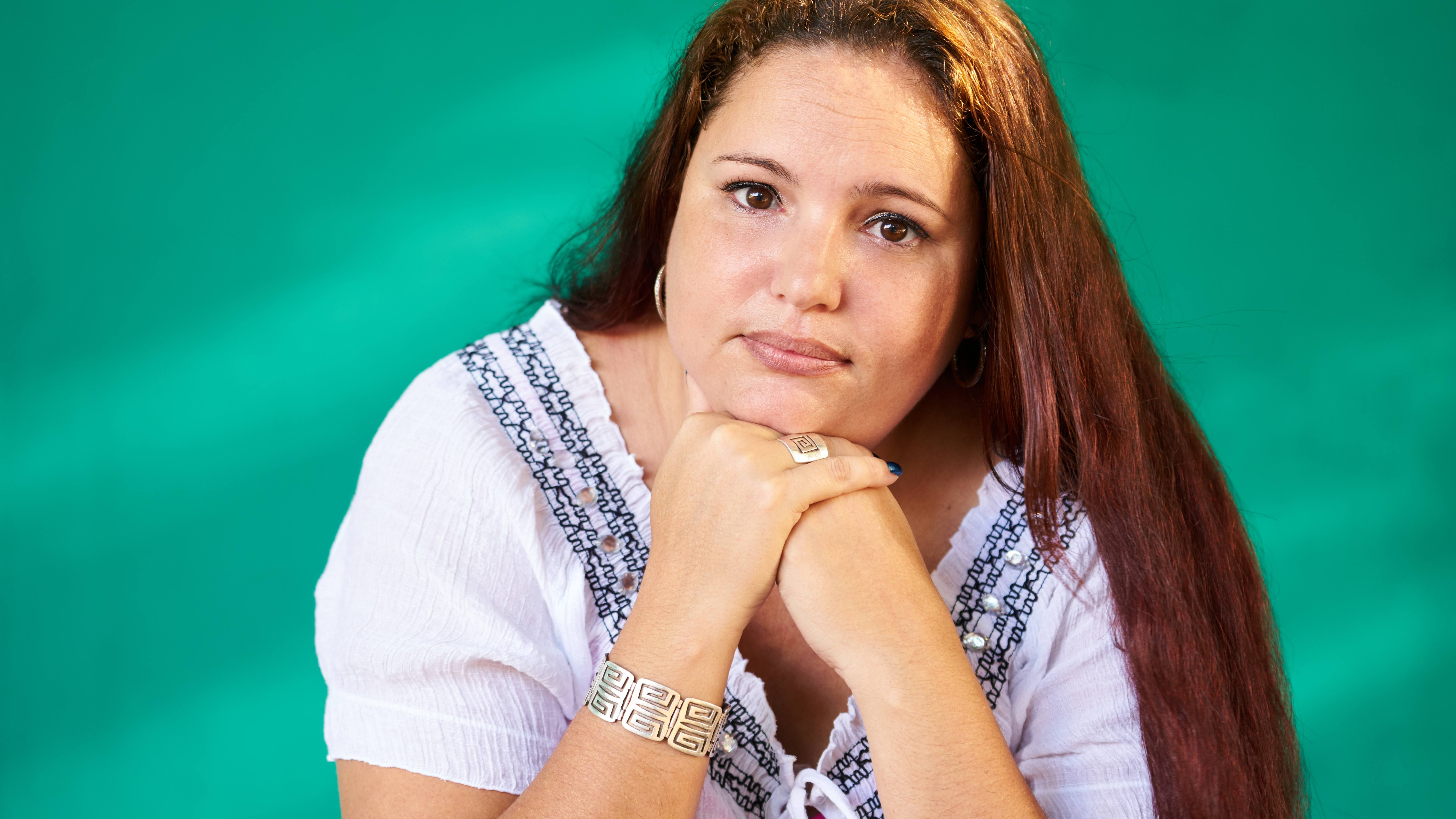 Portrait of sad overweight young woman looking at camera.