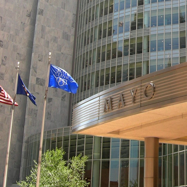 Entrance to Mayo Clinic Gonda building with flags flying outside