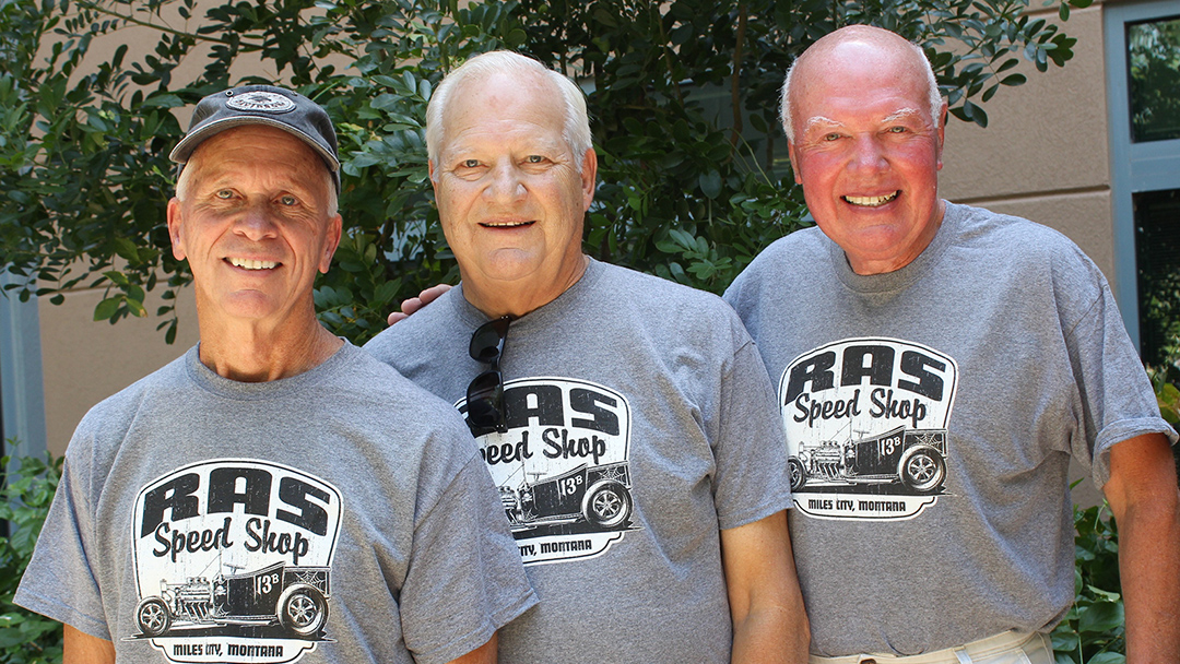 Left to right are Jim Ross, Fred Anderson and Ted Schreiber in matching grey t-shirts and smiling