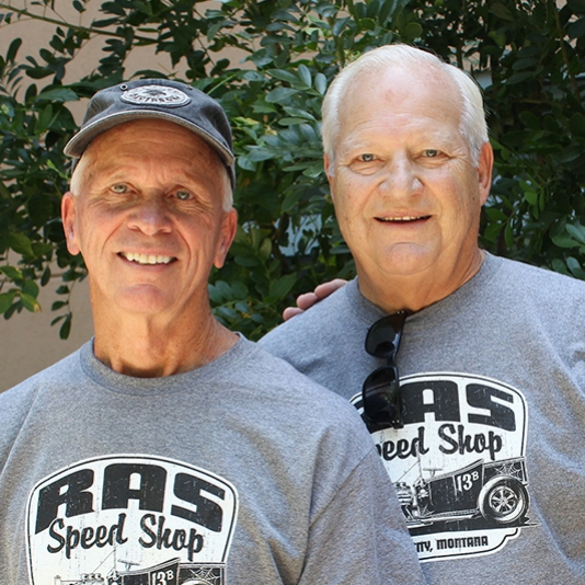 Jim Ross and Fred Anderson in matching grey t-shirts and smiling
