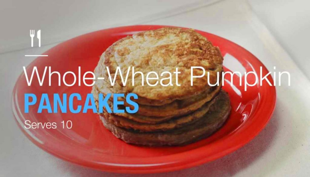 whole wheat pumpkin pancakes on an orange breakfast plate