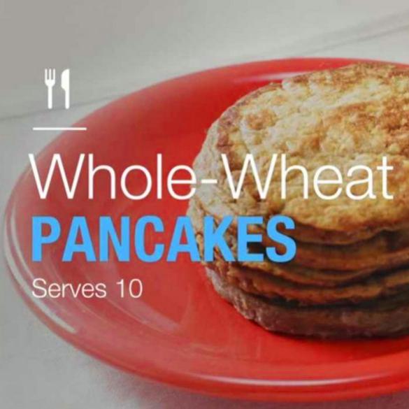 whole wheat pumpkin pancakes on an orange breakfast plate